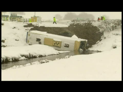 exterior shots overturned bus lying on its side by river. exterior shots crash scene with emergency services & rescue workers on site. a 17-year-old... - lying on side stock videos & royalty-free footage