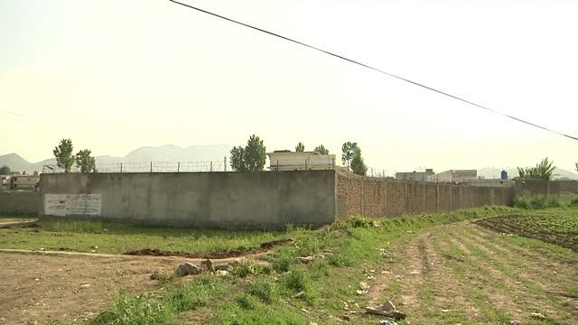 Exterior shots Pakistani police patrolling the hideout of AlQaeda leader Osama Bin Laden in Abbottabad on in Abbottabad Pakistan