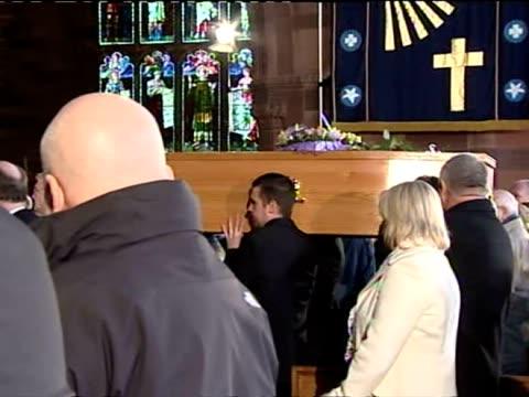exterior shots pall bearers carry coffin into church. interior shots coffin being carried into church. interior shots mourners singing hymn during... - såpopera bildbanksvideor och videomaterial från bakom kulisserna