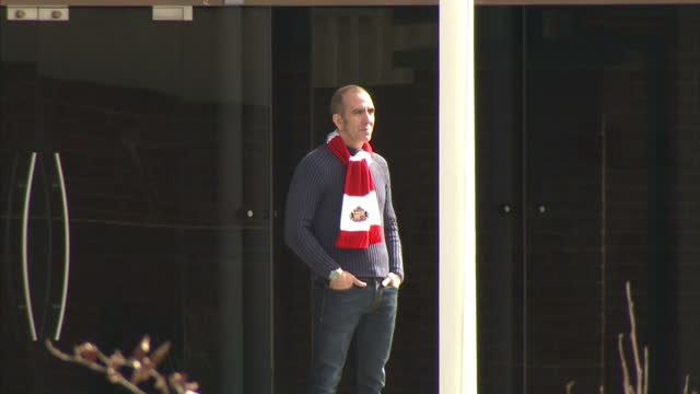 Exterior shots Paolo Di Canio poses for the media wearing a Sunderland FC scarf outside Sunderland FC stadiumThere's been anger amongst Sunderland...
