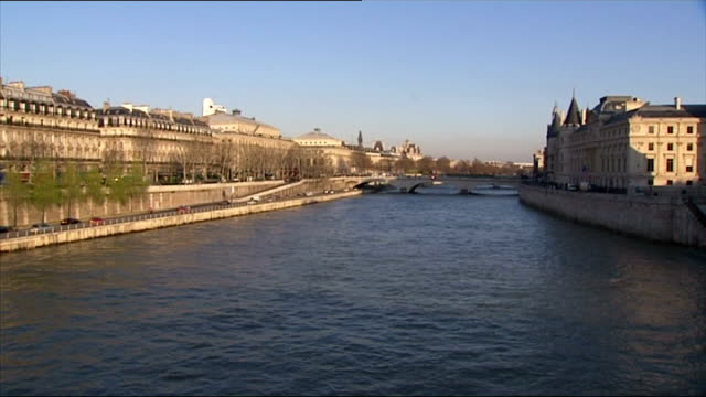 Exterior shots Paris streetscenes River Seine bridges National Assembly building French flags on poles Concorde Square Notre Dame Cathedral on March...