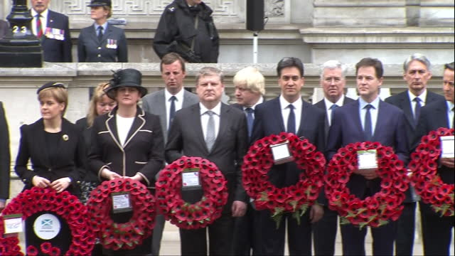 exterior shots party leaders lined up all holding wreaths for ve day commemoration at the cenotaph - david cameron, nick clegg, ed miliband, boris... - 70周年点の映像素材/bロール