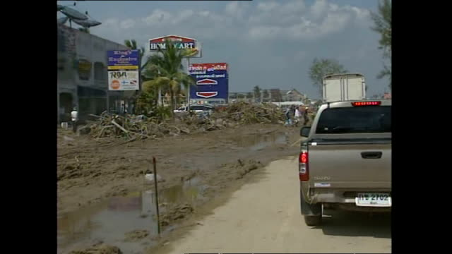 exterior shots passing through an area devastated by the tsunami and shots of police boat with the registration number 813 beached inland amongst... - 2004 stock-videos und b-roll-filmmaterial