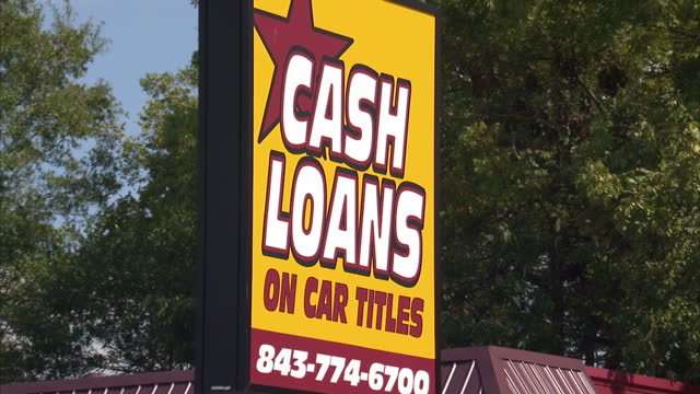 stockvideo's en b-roll-footage met exterior shots payday loans and cash loans signs at the side of the road and mounted on front of building on 19th october 2012 in dillon south... - lening