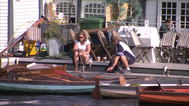 exterior shots people on pleasure boats on the thames exterior shots group of people eating lunch on boat exterior shots two shirtless rowing boat... - shirtless stock videos & royalty-free footage