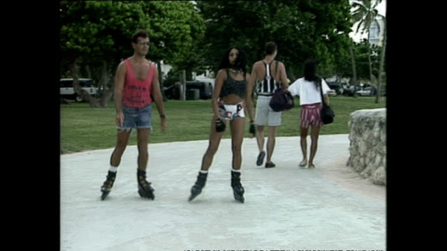 exterior shots people rollerblading along the miami beach promenade on september 01 1999 in miami florida - miami stock videos & royalty-free footage