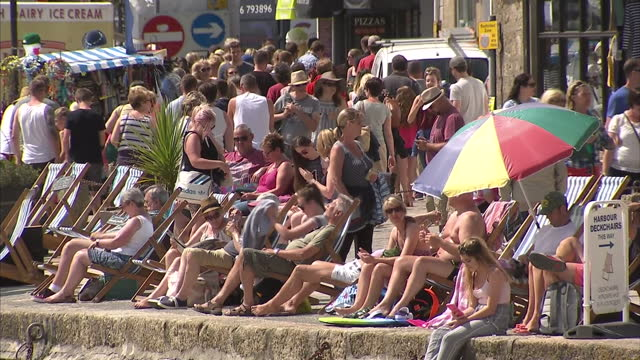 Exterior shots people sunbathing enjoying sunny weather on beach of St Ives on August 09 2016 in St Ives England