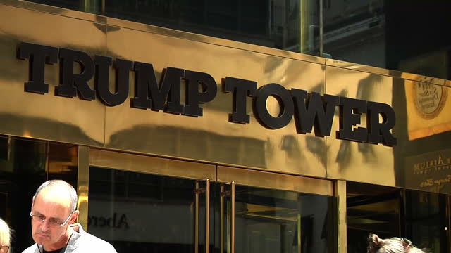 exterior shots people walking along street past trump tower and concierge waiting outside main entrance on june 7 2015 in new york city new york - main tower stock videos and b-roll footage