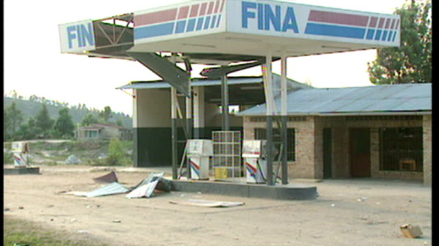 exterior shots petrol station badly damaged by fighting during the rwandan civil war on june 16 1994 in various cities rwanda - völkermord stock-videos und b-roll-filmmaterial