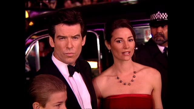 vídeos de stock, filmes e b-roll de exterior shots pierce brosnan actor with his partner keely shaye smith on the red carpet for the premiere of goldeneye the seventeenth james bond... - james bond trabalho conhecido