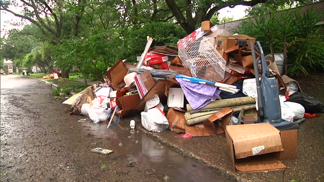 exterior shots piles of flood damaged carpets, furniture, household equipment outside houses on may 27, 2015 in houston, texas. - household equipment stock videos & royalty-free footage