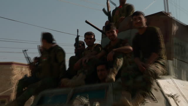 exterior shots point of view driving through town of bashiqa liberated from isis exterior shots peshmerga forces in bashiqa on november 13 2016 in... - isis stock videos and b-roll footage