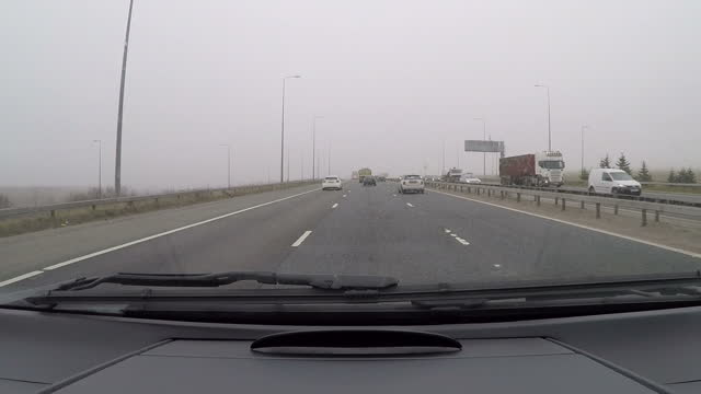 exterior shots point of view from travelling car on motorway towards leeds on march 16 2016 in leeds england - west yorkshire stock-videos und b-roll-filmmaterial