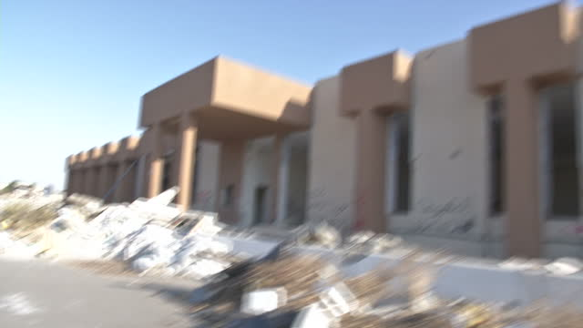 exterior shots pointofview from car of various ruined buildings and streets parts of gaddafi's ruined compound on july 02 2012 in az zawiyah libya - az zawiyah stock videos & royalty-free footage