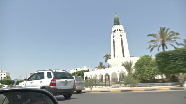 exterior shots pointofview from moving car various street scenes including mosque and election posters on july 02 2012 in az zawiyah libya - az zawiyah stock videos & royalty-free footage