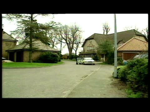 exterior shots police cars, vehicles & officers outside michael barrymore's essex home. general views police officers chatting to drivers of cars.... - michael barrymore stock-videos und b-roll-filmmaterial