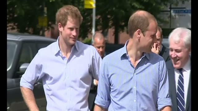 exterior shots police convoy arrives Prince Harry and Duke of Cambridge exit car greet awaiting official and enter building