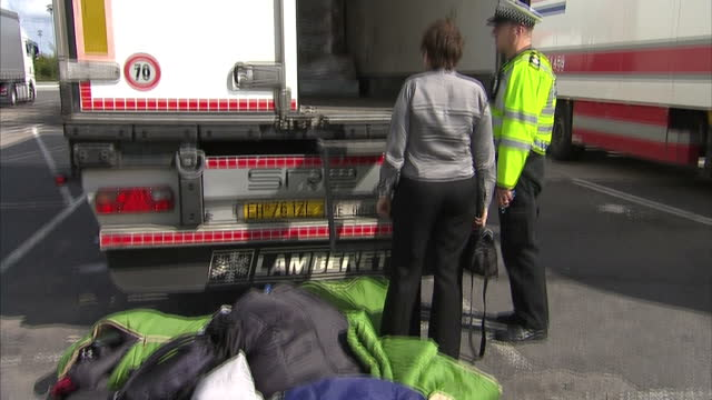Exterior shots police officers searching lorries after discovering illegal migrants inside lorry at motorway service station on August 28 2015 in...