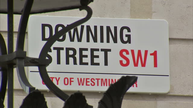 exterior shots police offocers stood outside the downing street gates. exterior close up shot downing street sign. exterior shot police officers... - close up stock videos & royalty-free footage