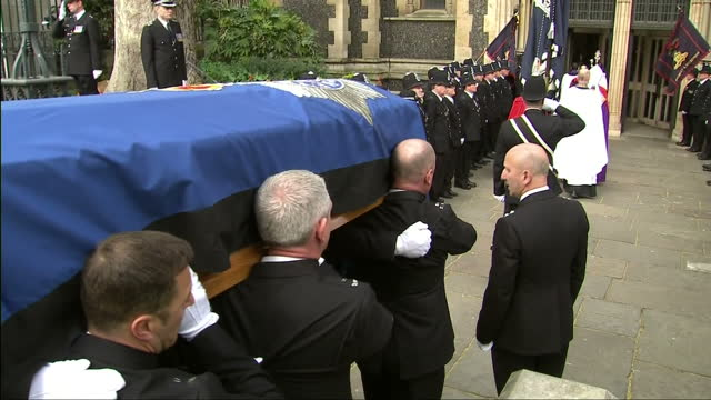Exterior shots police pallbearers carry coffin on PC Keith Palmer into Southwark Cathedral on 10 April 2017 in London United Kingdom