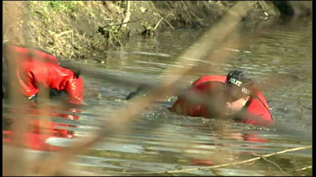 exterior shots police search team crawling through river searching for evidence after disappearance of claudia lawrence. on march 27, 2009 in york... - searching点の映像素材/bロール
