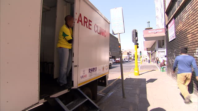 Exterior shots pop up aids clininc in the street of Johannesburg Lady Working In Mobile HIV Clinic on June 21 2010 in Johannesburg South Africa