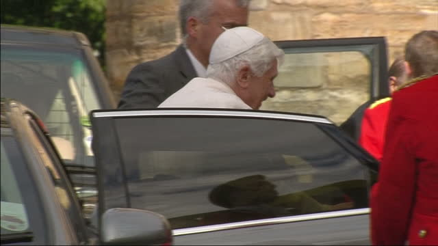 exterior shots pope benedict xvi greets queen elizabeth ii prince philip exterior shots the pope queen elizabeth ii walk up steps pose for photocall... - pope stock videos & royalty-free footage