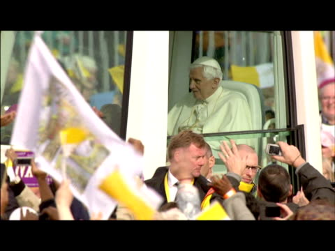 exterior shots pope benedict xvi travels through the cheering crowds in the pope mobile as he arrives in crofton park for open air mass blessing... - blessing stock videos & royalty-free footage