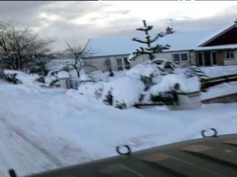 exterior shots pov driving through snowy country lanes exterior shots of soldiers unloading bread from truck and delivering it to shop - 水の形態点の映像素材/bロール