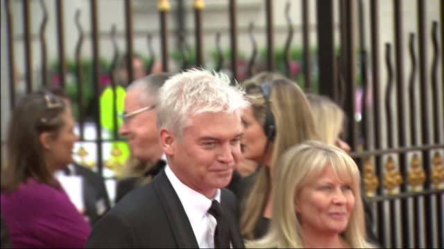 exterior shots presenter philip schofield poses on the red carpet with his wife bafta television awards red carpet arrivals on may 22, 2011 in... - phillip schofield stock videos & royalty-free footage