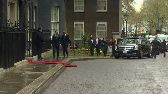 Exterior shots President Barack Obama arrives at Downing Street in Presidential state car and is greeted by David Cameron British Prime Minister as...
