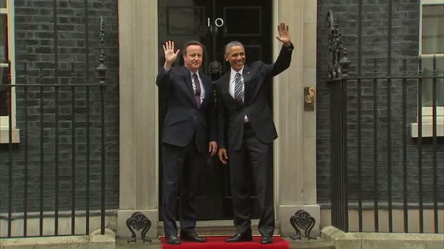 Exterior shots President Barack Obama arrives at Downing Street in Presidential state car and is greeted by David Cameron British Prime Minister the...