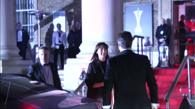 exterior shots prime minister david cameron his wife samantha both wearing evening wear get out of limousine enter the imperial war museum the... - limousine luxuswagen stock-videos und b-roll-filmmaterial