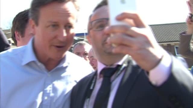 Exterior shots Prime Minister David Cameron leader of Conservative Party campaigning in Rothwell posing for selfie addressing supporters on April 21...