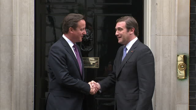 exterior shots prime minister david cameron shakes hands with portuguese prime minister pedro passos coelho both pose for the media interior shots... - traditionally portuguese stock videos and b-roll footage