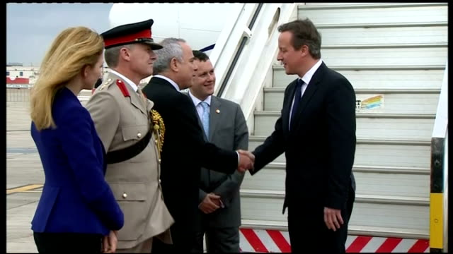 Exterior shots Prime Minister David Cameron walk off plane meeting diplomats stepping off plane on March 12 2014 in Jerusalem Israel