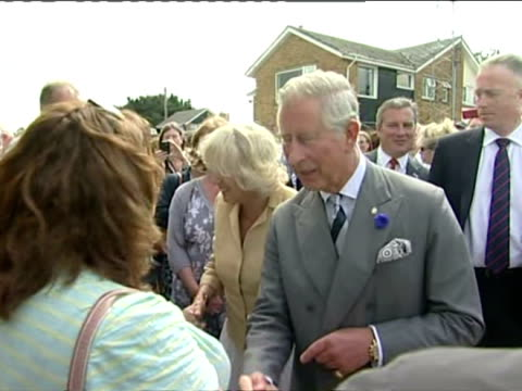Exterior shots Prince Charles and Camilla Duchess of Cornwall playing on steel drums on stage with band every ones having a laugh and enjoying...
