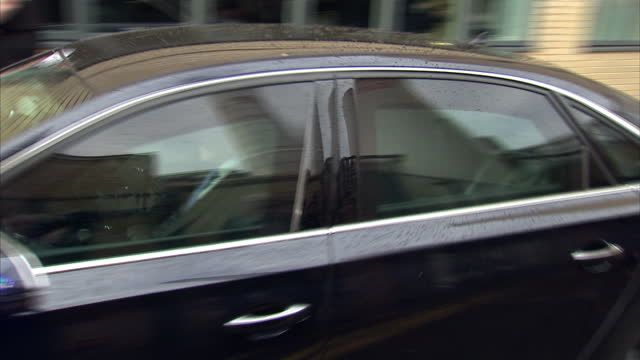 exterior shots prince charles bids goodbye to hospital officials as he exits the hospital and departs in car - 退院点の映像素材/bロール