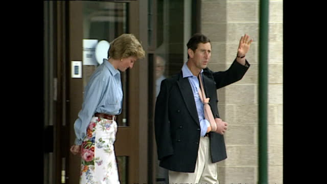 Exterior shots Prince Charles leaves Cirencester Hospital with his arm in a sling accompanied by Princess Diana