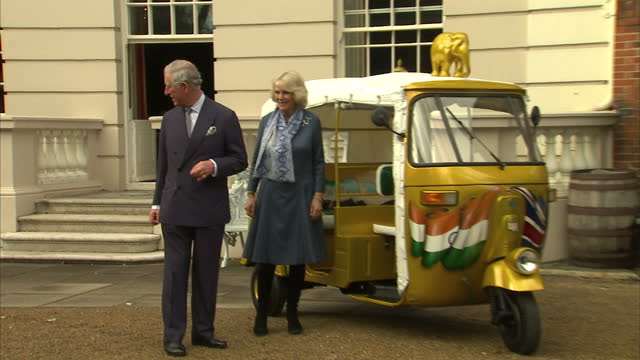 Exterior shots Prince Charles Prince of Wales and Duchess of Cornwall Camilla Parker Bowles getting into rickshaw tuk tuk at Clarence House on March...