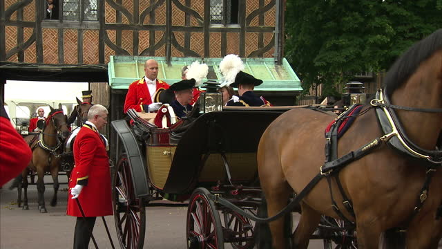 Exterior shots Prince Charles Prince of Wales Catherine Duchess of Cambridge and Prince William Duke of Cambridge leaving in horse drawn carriage...