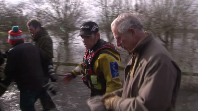 exterior shots prince charles, prince of wales getting out of boat used to access areas cut off by flooding. on in somerset, united kingdom. - somerset england stock videos & royalty-free footage