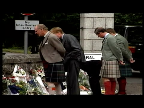 exterior shots prince charles, prince william, prince harry, queen & duke of edinburgh looking at floral tributes for princess - 1997 stock videos & royalty-free footage