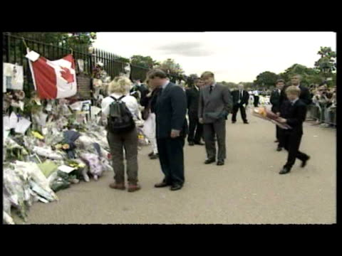 exterior shots prince charles, prince william & prince harry walkabout, meeting the public and looking at floral tributes to diana, princess of wales. - tribute event stock videos & royalty-free footage