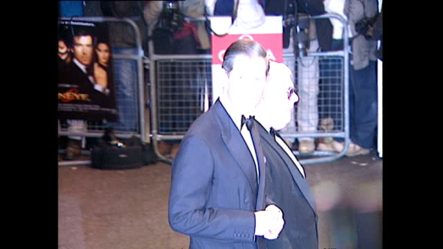 exterior shots prince charles pulls up in a black car and arrives on the red carpet for the premiere of goldeneye the seventeenth james bond film at... - royalty stock videos & royalty-free footage