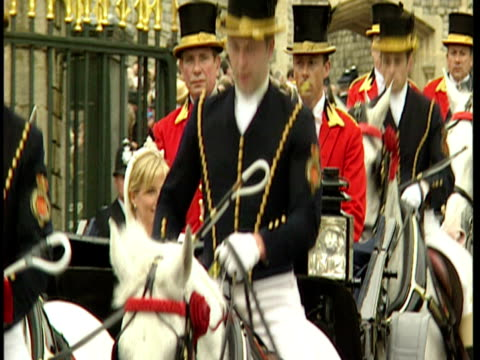 stockvideo's en b-roll-footage met exterior shots prince edward sophie rhys jones are driven past in horse drawn carriage after their wedding ceremony prince edward sophie rhys jones... - 1999