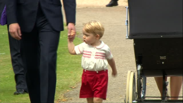 Exterior shots Prince George of Cambridge walking holding hand of Prince William as the arrive at Church of St Mary Magdalene for christening of...