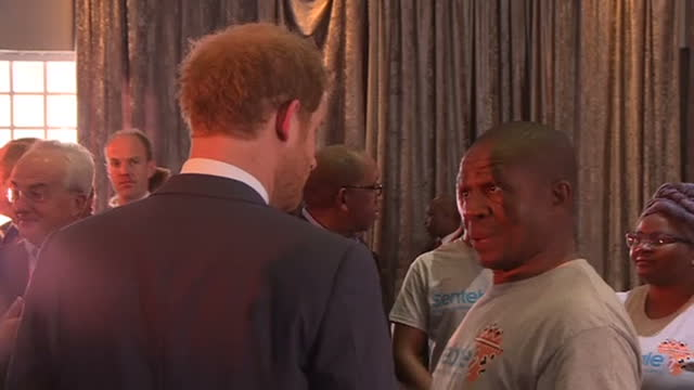 exterior shots prince harry joking with charity workers performs funny little shoulder dance then talks to man - hiv aids conference stock videos & royalty-free footage