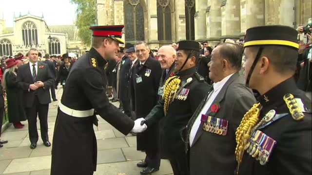 exterior shots prince harry meeting servicemen veteran soldiers tip hats an salute the prince - kopfbedeckung stock-videos und b-roll-filmmaterial