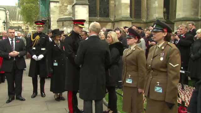 exterior shots prince harry shakes hands and speaks with widow lisa mckinlay - vedova video stock e b–roll